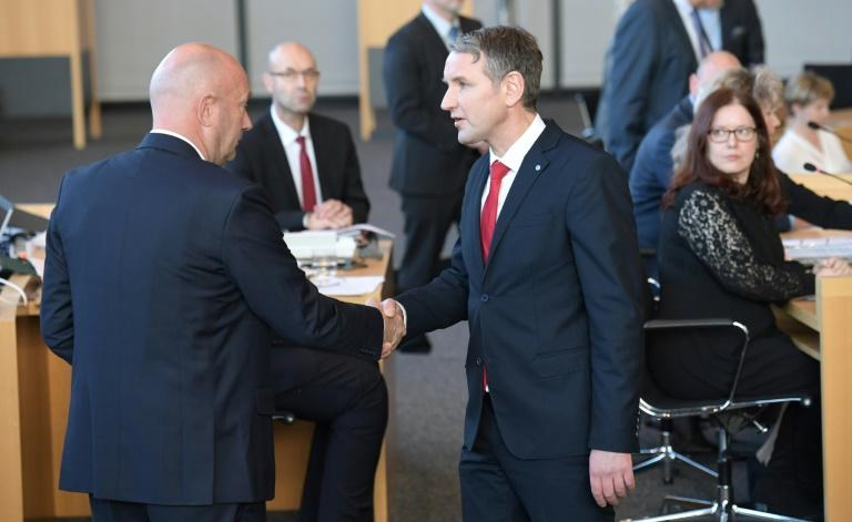 Bjoern Hoecke, chairman of far-right AfD group in the eastern state of Thuringia (R) congratulates Free Democrat Thomas Kemmerich (L), newly elected regional leader, with AfD help