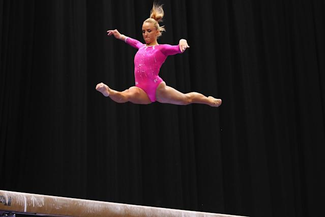 ST. LOUIS, MO - JUNE 8: Nastia Liukin competes on the balance bar during the Senior Women's competition on day two of the Visa Championships at Chaifetz Arena on June 8, 2012 in St. Louis, Missouri. (Photo by Dilip Vishwanat/Getty Images)