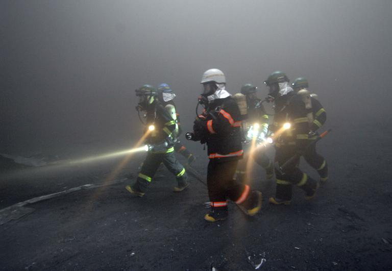 File photo of South Korean firefighters, pictured in Icheon, south of Seoul, on January 7, 2008