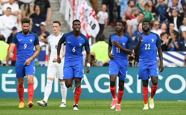 Midfielder Paul Pogba, second left, and Ousmane Dembele, third left, appear for France in a recent international friendly against England (AFP Photo/FRANCK FIFE)