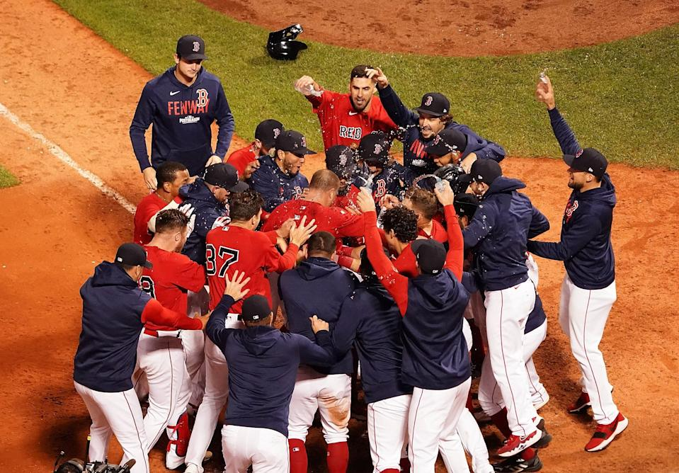 Red Sox players celebrate Christian Vazquez's walk-off homer in the 13th inning of Game 3.