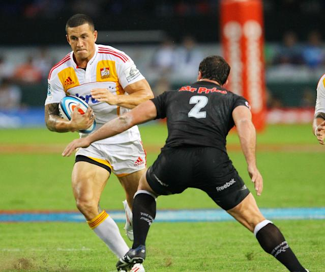 New Zealand Waikato Chiefs' Sonny Bill Williams (L) tries to avoid the tackled of Durban Sharks' Bismarck du Plessis during a Super 15 rugby union match at the Mr Price Kings Park Rugby Stadium on April 21, 2012. AFP PHOTO (Photo credit should read -/AFP/Getty Images)
