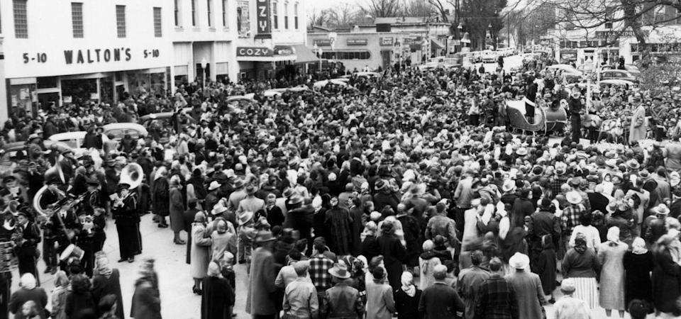 <p>Walton's 5&10 discount store became quite the success. It had a central location right in the heart of Bentonville Square, as pictured here, during a Christmas event in 1950.</p><p>Photo: Courtesy of The Walmart Museum</p>