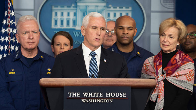 Vice President Mike Pence, standing with members of the White House Coronavirus Task Force team, speaks during a press briefing in the press briefing room of the White House March 15, 2020 in Washington, DC. (Jim Watson/AFP via Getty Images)