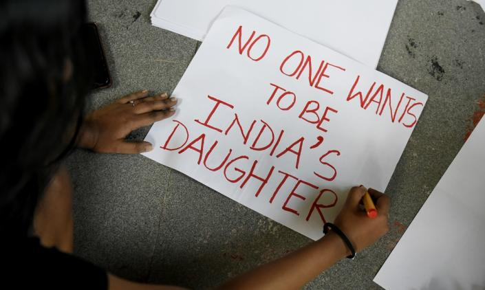 Students shout slogans, write posters and acts to protest against the alleged rape and murder of a 27-year-old veterinary doctor in Hyderabad, during a demonstration in Kolkata, India on December 02, 2019. (Photo by Indranil Aditya/NurPhoto via Getty Images)