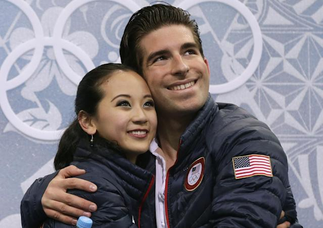 Felicia Zhang and Nathan Bartholomay of the United States embrace in the results area after competing in the pairs free skate figure skating competition at the Iceberg Skating Palace during the 2014 Winter Olympics, Wednesday, Feb. 12, 2014, in Sochi, Russia. (AP Photo/Darron Cummings)