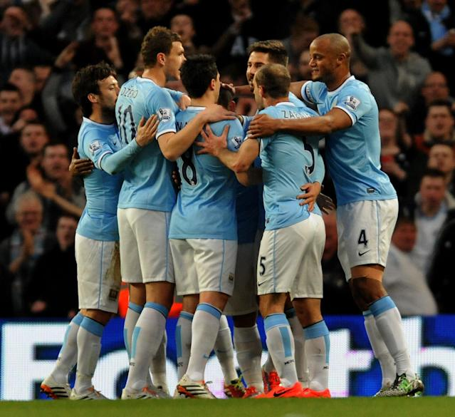 Manchester City players celebrate after Sergio Aguero scored against West Bromich Albion during their English Premier League soccer match at the Etihad Stadium, Manchester, England, Monday April 21, 2014. (AP Photo/Rui Vieira)