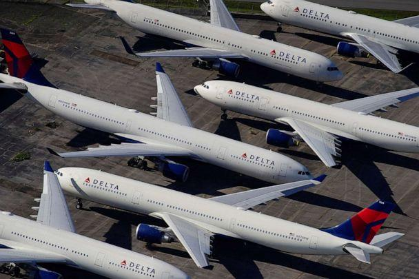 PHOTO: Delta Air Lines passenger planes are seen parked due to flight reductions made to slow the spread of coronavirus disease, at Birmingham-Shuttlesworth International Airport in Birmingham, Ala., March 25, 2020. (Elijah Nouvelage/Reuters, FIle)