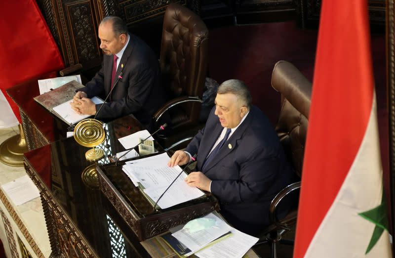 Parliament Speaker Hammouda Sabbagh heads a parliament session to discuss upcoming presidential election in Damascus