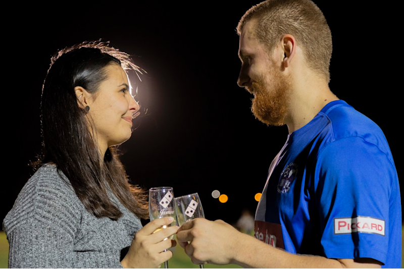 The pair kept things cheesy with their pizza proposal. Photo: Dominos