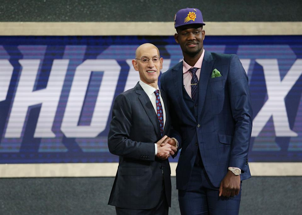 Deandre Ayton greets NBA commissioner Adam Silver after being selected as the No. 1 overall pick to the Phoenix Suns at the 2018 NBA draft. (Brad Penner/USA TODAY Sports)