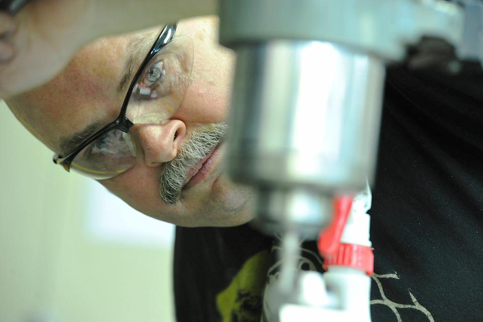 Clint Kauffman jumped at the chance to enroll his stepson at Tennessee College of Applied Technology through the Tennessee Reconnect grant. Kauffman works in the machine shop building a fly cutter in this 2015 file photo.