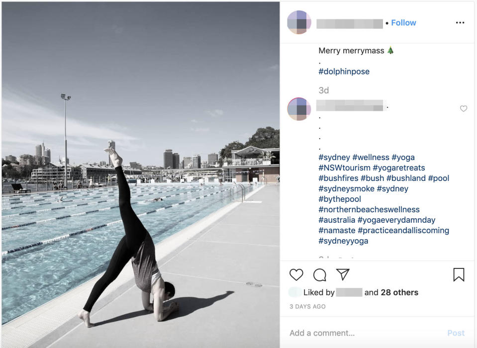 A person performs a yoga pose next to a Sydney swimming pool.