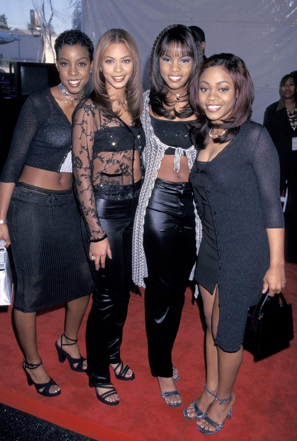 <p>Wearing matching black outfits at the 1998 Soul Train Music Awards.</p>