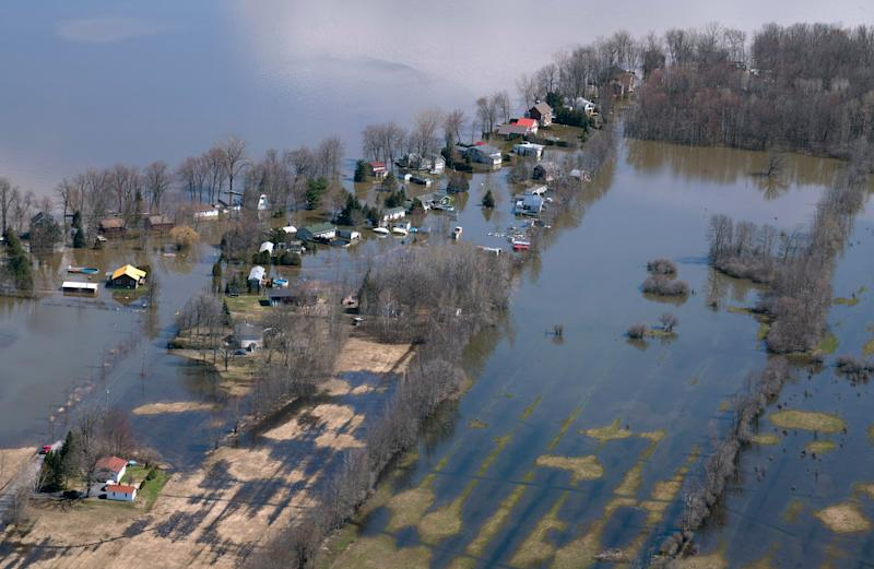 A flooded neighborhood is seen in Rigaud, Quebec, Canada on Tuesday, April 30, 2019. Thousands of people have been forced from their homes in Quebec, Ontario and New Brunswick. (Paul Chiasson/The Canadian Press via AP)