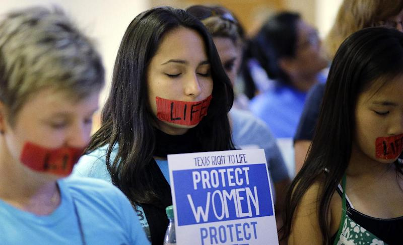 Supporters of an abortion bill demonstratet5 outside of a hearing for the bill at the state capitol, Tuesday, July 2, 2013, in Austin, Texas. Gov. Rick Perry has called lawmakers back for another special session with abortion on the top of the agenda. (AP Photo/Eric Gay)