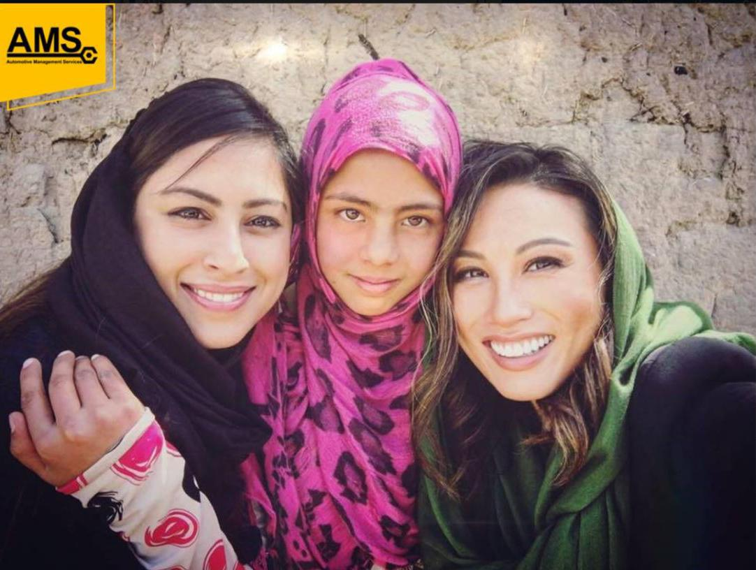 Mina Chang and unnamed others in Afghanistan in a photo from the Facebook page of Automotive Management Services (AMS), a defense contractor operating in Afghanistan.