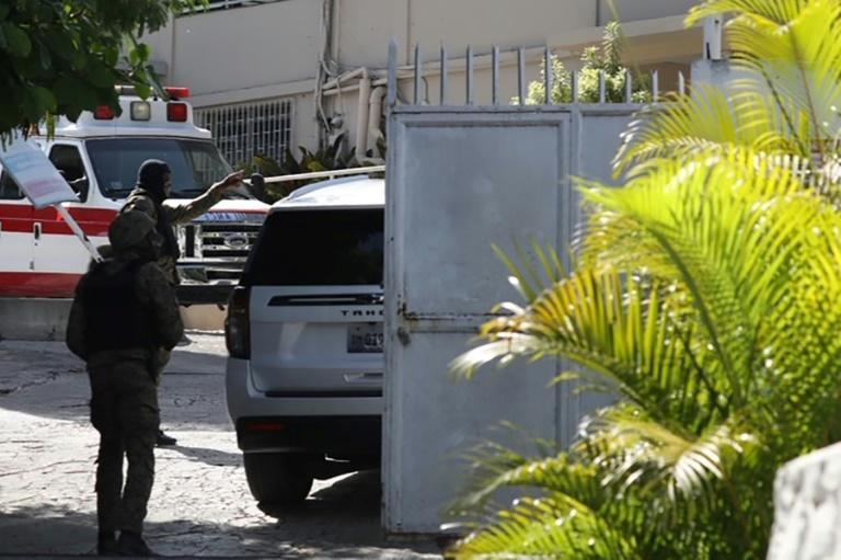 Vehicles and security members near the hospital where Haitian First Lady Martine Moise was taken on July 7, 2021 in Port-au-Prince, Haiti