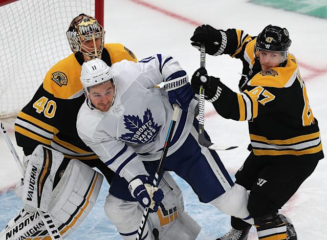 Hyman, centre, was involved in one of the controversial interference calls in the first round. (Photo by John Tlumacki/The Boston Globe via Getty Images)