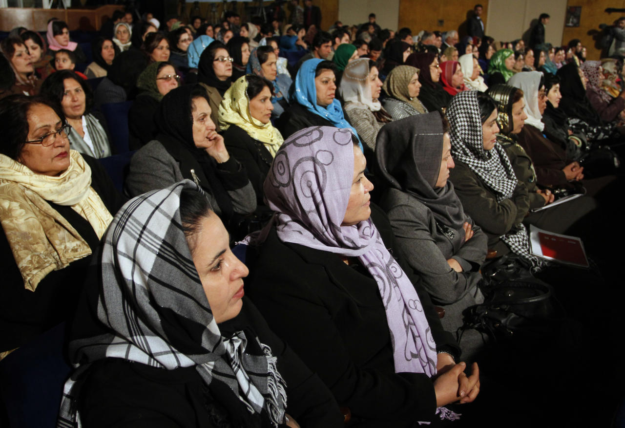 Afghan women listen to Afghan President Hamid Karzai, during a speech about women's rights, in Kabul, Afghanistan on Wednesday, Nov. 24, 2010. President Hamid Karzai said he was happy the results from the Sept. 18 elections were being announced, and called on losing candidates not to take their complaints to the streets but instead to those empowered to deal with them.