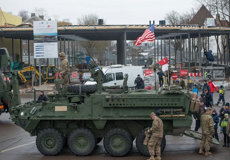 A US flag flies from the back of a tank parked in front of an Estonia-Russia border point during a military parade to celebrate 97 years since first achieving independence in 1918 on February 24, 2015 in Narva, Estonia (AFP Photo/Raigo Pajula)