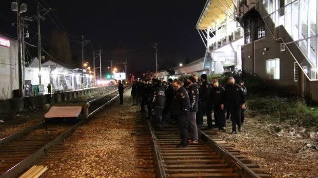 Vancouver Police officers cleared a blockade of railway tracks near Renfrew and East Broadway early Saturday.