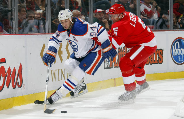 DETROIT, MI - NOVEMBER 11: Ryan Smyth #94 of the Edmonton Oilers carries the puck as he is checked by Nicklas Lidstrom #5 of the Detroit Red Wings during their NHL game at Joe Louis Arena November 11, 2011 in Detroit, Michigan. (Photo by Dave Sandford/Getty Images)