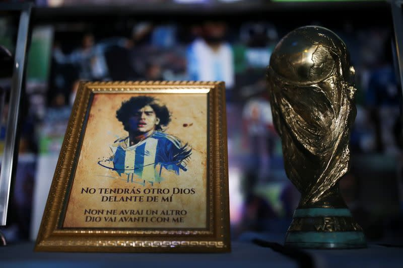 A Maradona's picture and an replica of the World Cup trophy are pictured on an altar at the first Mexico's church in memory of soccer legend Diego Armando Maradona in San Andres Cholula