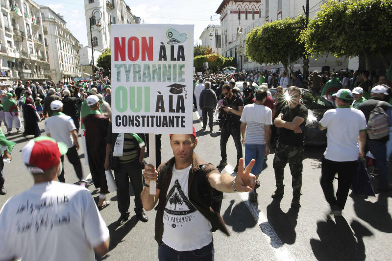 "Algerian protesters gather during an anti-government demonstration in the centre of the capital Algiers, Algeria, Friday, May 31, 2019. Banner in French reads ""No to tyranny, yes to constitution."" (AP Photo/Fateh Guidoum)"