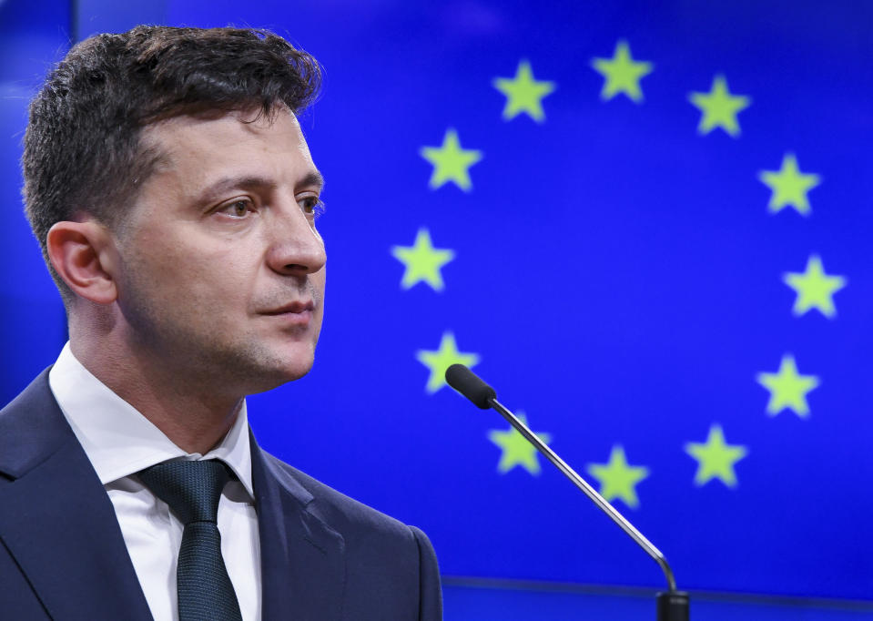 """FILE - In this Wednesday, June 5, 2029 file photo, Ukrainian President Volodymyr Zelenskyy speaks during a media conference at the Europa building in Brussels. The European Union is considering providing a military training mission to Ukraine amid lingering tensions between Russia and the Soviet ex-republic, officials said Monday, Oct. 11, 2021. Acting on a request from Ukraine for help in the """"professional military education,"""" the EU has already sent a fact-finding mission to the country last month. (AP Photo/Riccardo Pareggiani, File)"""