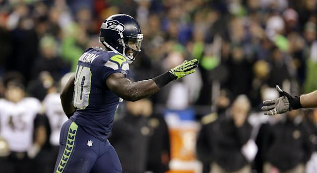 Seattle Seahawks' Derrick Coleman is greeted as he leaves the field after scoring a touchdown against the New Orleans Saints in the second half of an NFL football game, Monday, Dec. 2, 2013, in Seattle. (AP Photo/Elaine Thompson)