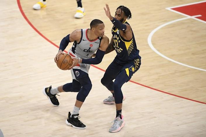 Washington Wizards guard Russell Westbrook (4) in action against Indiana Pacers forward Oshae Brissett (12) during the second half of an NBA basketball Eastern Conference play-in game, Thursday, May 20, 2021, in Washington. (AP Photo/Nick Wass)