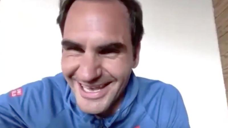 Pictured here, Roger Federer laughs after his coach interrupts a live chat to check up on him.