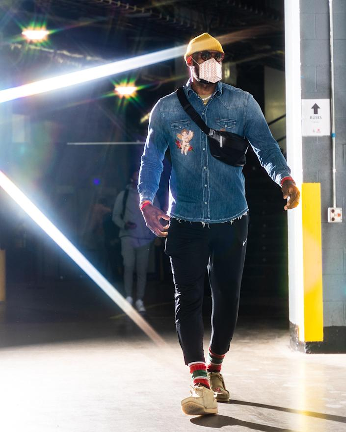 LeBron James of the Los Angeles Lakers arrives for a game against the Rockets, in Houston January 12, 2021.