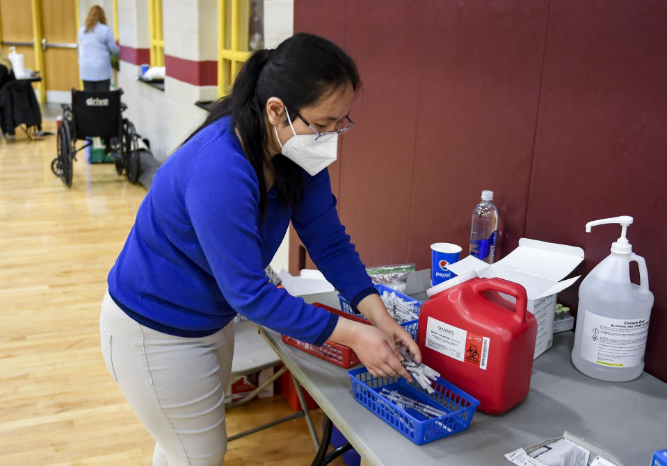 Reading, PA - April 12: Pharmacist Dr. Uyen Ngo with some syringes ready to administer doeses of COVID-19 vaccine. At Alvernia University in Reading, PA Monday morning April 12, 2021 where the school, working with Rite Aid Pharmacy, held a COVID-19 vaccination clinic administering doses of the Pfizer-BioNTech vaccine for staff and students in the Physical Education Center. (Photo by Ben Hasty/MediaNews Group/Reading Eagle via Getty Images)