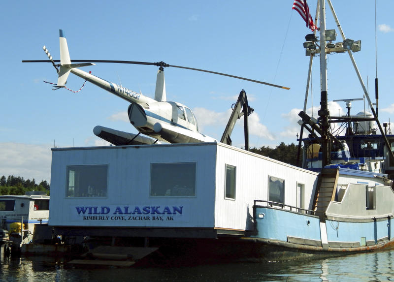 "FILE - This 2014 file photo, shows the Wild Alaskan, a converted crabbing boat that had been used as a strip club, moored near downtown Kodiak, Alaska. Its owner, Darren Byler, is resurrecting the controversial strip club on board his boat, billing the enterprise as a nightly protest months after he was sentenced to probation for dumping human waste from the vessel. Byler, who is appealing the case, says he will begin his summer-long ""First Amendment Freedom of Assembly"" protests, complete with exotic dancers, Thursday May 18, 2017. (Kodiak Daily Mirror via AP, File)"