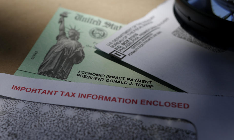 FILE - In this April 23, 2020, file photo, President Donald Trump's name is seen on a stimulus check issued by the IRS to help combat the adverse economic effects of the COVID-19 outbreak, in San Antonio. All that aid is now gone. Yet prospects for more federal stimulus this year appear all but dead, clouding the future for the unemployed, for small businesses and for the economy as a whole.(AP Photo/Eric Gay, File)