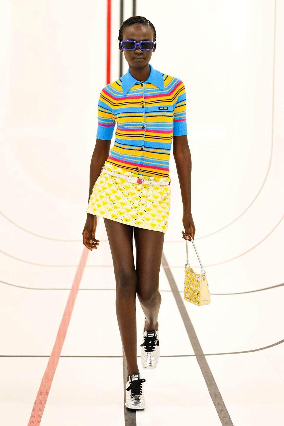 """<h2>Micro-Minis</h2><br>Mrs. Prada continued to fight against bulky, layered-on fashion with the reintroduction of micro-mini skirts and -dresses at her Miu Miu show. And like the equally revealing midriff-baring tops, minis were popular across the board, with ultra-short bottoms also presented at Giambattista Valli, Hermes, Isabel Marant, and Coperni, among others. You heard it here first: 2021 will be known as the year of the gams. <br><br><em>Miu Miu</em><span class=""""copyright"""">Photo Courtesy of Miu Miu.</span>"""
