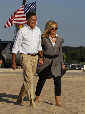 Mitt Romney and his wife Ann, walk barefoot in the sand towards Lake Michigan at Holland State Park in Michigan June 19, 2012.