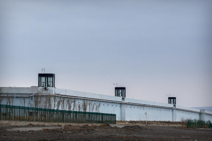 People stand in a guard tower on the perimeter wall of the Urumqi No. 3 Detention Center in Dabancheng in western China's Xinjiang Uyghur Autonomous Region on April 23, 2021. China's largest detention center is twice the size of Vatican City and has room for at least 10,000 inmates. (AP Photo/Mark Schiefelbein)