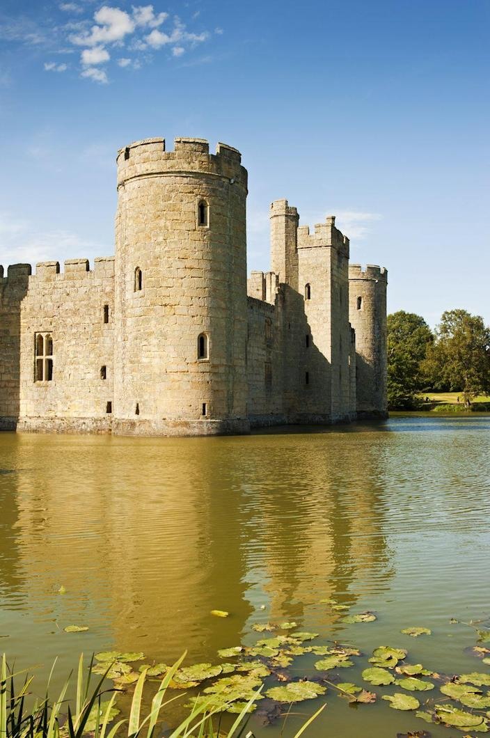 <p>This moated castle was built in the 14th century in East Sussex, England, by a knight looking to protect the area against the French during the Hundred Years' War. But after surviving several wars, it was abandoned, and today it serves as a tourist attraction that's open to the public.</p>