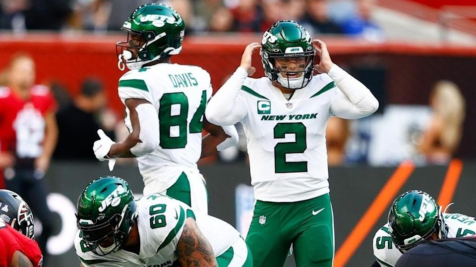 Oct 10, 2021; London, England, United Kingdom; New York Jets quarterback Zach Wilson (2) calls a play at the line of scrimmage in the first half against the Atlanta Falcons at Tottenham Hotspur Stadium.