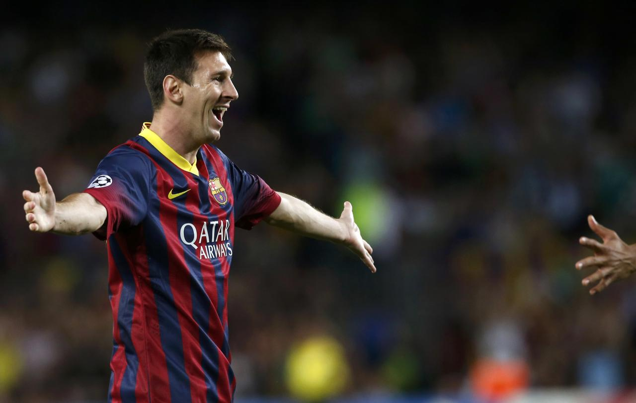 Barcelona's Lionel Messi celebrates scoring a goal against Ajax during their Champions League soccer match at Camp Nou stadium in Barcelona September 18, 2013. REUTERS/Albert Gea (SPAIN - Tags: SPORT SOCCER TPX IMAGES OF THE DAY)