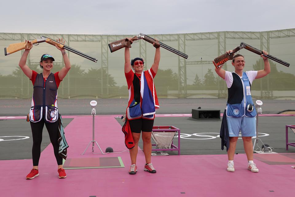 <p>ASAKA, JAPAN - JULY 29: (L-R) Silver Medalist Kayle Browning of Team United States, Gold Medalist Zuzana Rehak Stefecekova of Team Slovakia, and Bronze Medalist Alessandra Perilli of Team San Marino celebrate following the Trap Women's Finals on day six of the Tokyo 2020 Olympic Games at Asaka Shooting Range on July 29, 2021 in Asaka, Saitama, Japan. (Photo by Kevin C. Cox/Getty Images)</p>