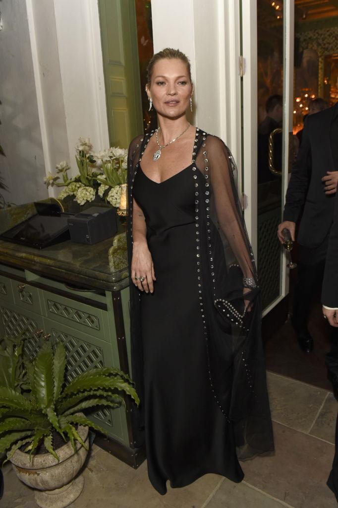 <p>Original super, Kate Moss, donned all-black and accessorised the high-fashion look with Bulgari jewels. <em>[Photo: Getty]</em> </p>