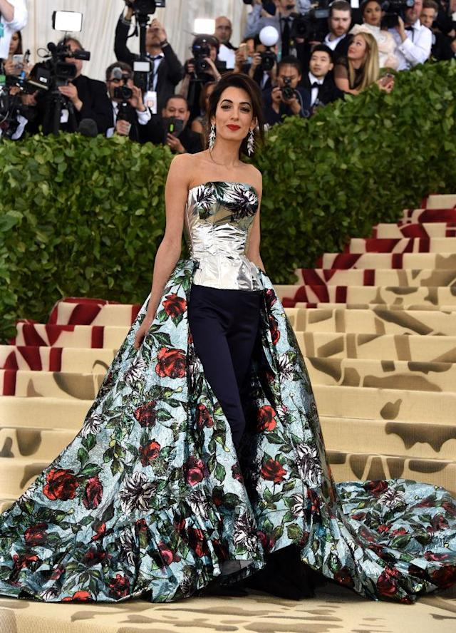 "<p>Clooney also stunned in a custom Richard Quinn ensemble, which included <a href=""https://www.yahoo.com/lifestyle/amal-clooney-wears-pants-fanciest-red-carpet-year-222655617.html"" data-ylk=""slk:satin pants;outcm:mb_qualified_link;_E:mb_qualified_link"" class=""link rapid-noclick-resp newsroom-embed-article"">satin pants</a>. (Photo: Getty Images) </p>"