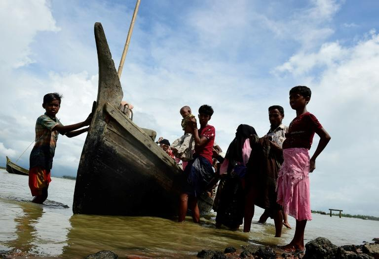 Rohingya Muslim refugees disembark from a boat on the Bangladeshi side of Naf river in Teknaf on September 12, 2017