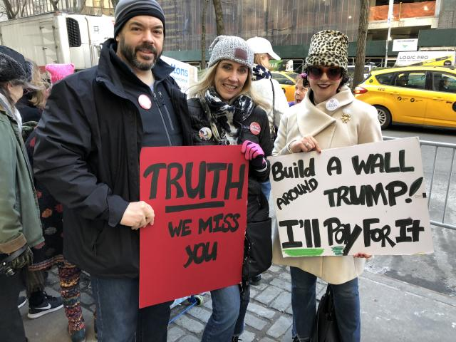 Marc Allen, Barbara Spitzer, and Ann Marie Morris with their signs. (Photo: Lisa Belkin/Yahoo News)