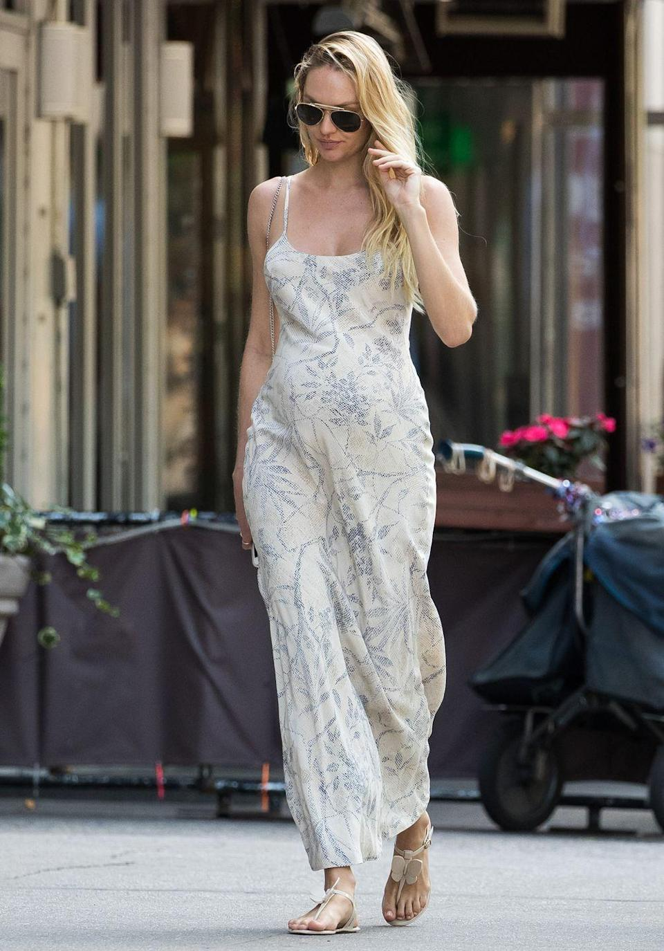 <p>Candice Swanepoel kept things simple in a maxi sundress.</p>