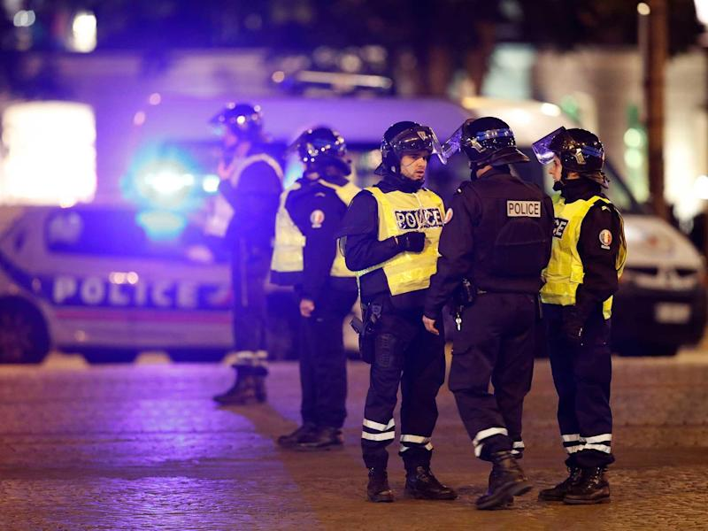 Police secure the Champs Elysees Avenue after one policeman was killed and another wounded in a shooting: Reuters